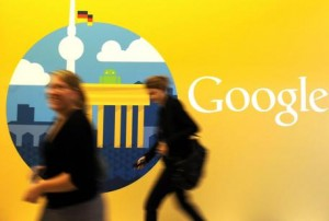 epa03437898 (FILE) A file photo dated 26 September 2012 showing women walking past the company logo in the offices of the subsidiary of Google in Berlin, Germany. Trading in Google shares was halted in New York after company results were made public before the closing bell, 18 October 2012. The company said its third quarter profits fell 20 per cent on a year to 2,18 billion USD, well below analysts' estimates.  EPA/BRITTA PEDERSEN