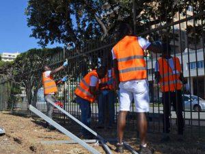 I migranti al lavoro in piazzale Kennedy
